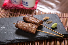 Japanese Wagyu Beef Kushiyaki, Skewered and Grilled Meat. 2 pieces grilled skewered wagyu beef on a plate Stock Images