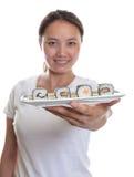 Japanese Waitress offering sushi  Royalty Free Stock Photos