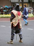 Japanese warrior. Wearing specific equipment during a street festival in Japan in a rainy day Stock Photography