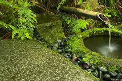 Japanese water bamboo fountain Royalty Free Stock Images