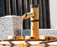 Japanese water basin from bamboo pipe washing hand Royalty Free Stock Photos