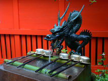 Japanese water dragon. Traditional sculpture of japanese dragon near the temple entrance Stock Photos
