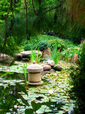 Japanese Water Garden. With Stone Pagoda and Waterlilies Stock Photography
