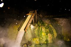 A japanese water mill. In the night Stock Photo