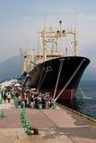 Japanese Whaling ship Nishin Maru. Kagoshima City, Japan, April 27, 2008, People waiting in line to board the whaling factory ship Nisshin Maru, berthed at a stock images