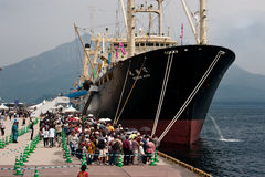 Japanese Whaling ship Nishin Maru. Kagoshima City, Japan, April 27, 2008, People waiting in line to board the whaling factory ship Nisshin Maru, berthed at a stock image