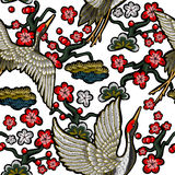 Japanese white cranes with red flowers. Royalty Free Stock Image