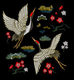 Japanese white cranes with red flowers. Embroidery vector Stock Photo