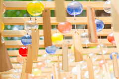 Japanese Wind Chime Festival in Kawagoe, Japan. KAWAGOE, JAPAN - 20 JULY 2016 - Colorful glass wind chimes hang from wood structure during Wind Chime Festival at Royalty Free Stock Photos