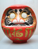 Japanese wish doll (daruma). You can make a wish by marking one of its' eye. When the wish comes true, mark the second eye stock photography
