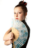 Japanese woman. Portrait of a girl in japanese national clothes with fan. White background. Studio shot Royalty Free Stock Photography
