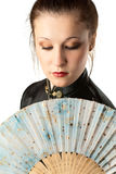 Japanese woman. Portrait of a woman in japanese national clothes with fan. White background. Studio shot Royalty Free Stock Photography