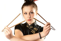 Japanese woman. Portrait of a girl in national japanese clothes with chopsticks Stock Photography