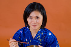 Japanese woman with chopsticks Royalty Free Stock Image
