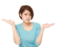 Japanese woman confused Stock Photo