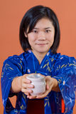 Japanese woman with cup of tea Royalty Free Stock Photos