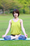 Japanese woman doing meditation Stock Photos