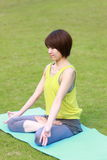 Japanese woman doing meditation Royalty Free Stock Photo