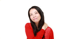 Japanese woman doing self shoulder massage Royalty Free Stock Photography