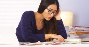 Japanese woman doing taxes Royalty Free Stock Photos
