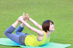 Japanese Woman Doing YOGA bow pose Royalty Free Stock Photos