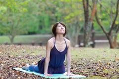 Japanese Woman Doing YOGA cobra pose Stock Photo