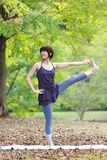 Japanese Woman Doing YOGA Extended Hand-To-Big-Toe Pose. Portrait of Japanewe woman doing yoga exercise outdoor stock images