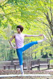 Japanese Woman Doing YOGA Extended Hand-To-Big-Toe Pose. Portrait of Japanewe woman doing yoga exercise outdoor royalty free stock photo