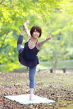 Japanese Woman Doing YOGA lord of the dance pose Stock Photos