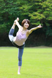 Japanese Woman Doing YOGA lord of the dance pose Royalty Free Stock Photo