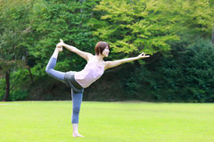 Japanese Woman Doing YOGA lord of the dance pose Stock Photography