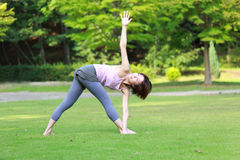 Japanese Woman Doing YOGA. Portrait of Japanewe woman doing yoga exercise outdoor Royalty Free Stock Photography