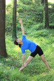 Japanese woman doing yoga triangle pose Stock Photos