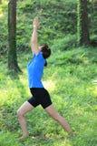 Japanese woman doing yoga warrior I pose Royalty Free Stock Photos
