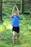 Japanese woman doing yoga warrior I pose Stock Photography