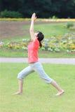 Japanese woman doing yoga warrior I pose Royalty Free Stock Photo
