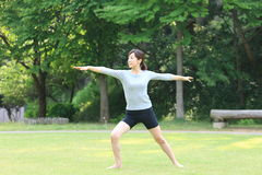 Japanese woman doing yoga warrior II pose Royalty Free Stock Photography