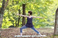 Japanese Woman Doing YOGA warrior II pose Stock Image