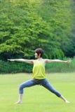 Japanese Woman Doing YOGA warrior II pose Stock Photos