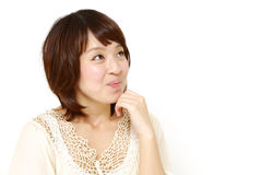 Japanese woman dreaming at her future Royalty Free Stock Image