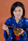 Japanese woman eating food Stock Photos