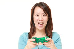 Japanese woman enjoying a video game Royalty Free Stock Photos