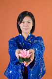 Japanese woman with flower Stock Images