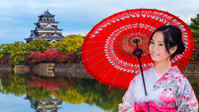 Japanese Woman in front of Hiroshima Castle Stock Images