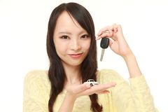 Japanese woman get a new car. Studio shot of young Japanese woman's portrait on white background Stock Image