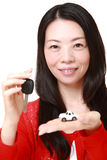 Japanese woman get a new car. Studio shot of young Japanese woman on white background Stock Photos