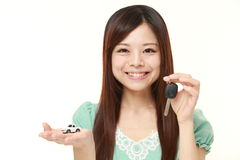 Japanese woman get a new car. Studio shot of young Japanese woman on white background Royalty Free Stock Photography