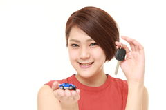Japanese woman get a new car. Studio shot of young Japanese woman on white background Royalty Free Stock Images