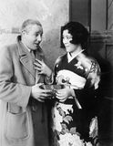 Japanese woman giving a man a present Stock Images