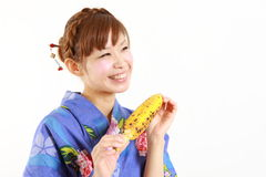 Japanese woman with grilled corn Royalty Free Stock Image